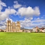 Wells Cathedral Somerset UK. The West Front of Wells Cathedral and Cathedral Green, Wells, Somerset, England, UK. Wells Cathedral is considered to be one of the royalty free stock image
