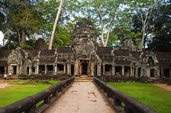 West gate of Ta Prohm, Angkor, Cambodia. Jungle temple with massive trees growing out of its walls royalty free stock photography