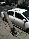 West Hollywood, CA / United States -  May 6, 2011: White Car hits light pole on street Sunset Blvd., West Hollywood with damage stock images