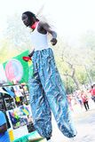 West Indian Day Parade Entertainer On Stilts. Stock Image