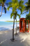 West Indies, Caribbean, Antigua, St Georges, Dickenson Bay, Beach & Red Telephone Box. View of Beach & Red Telephone Box, West Indies, Caribbean, Antigua, St stock photo