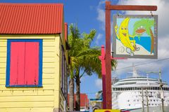 West Indies, Caribbean, Antigua, St Johns, Colourful Sign On Redcliffe Street & Cruise Ship Stock Image