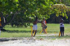 West Indies, Caribbean, Antigua, St Mary, Ffryes Beach, Youngsters Playing Cricket on the Beach Royalty Free Stock Photos