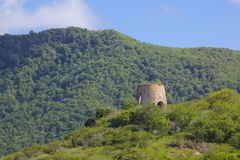 West Indies, Caribbean, Antigua, St Mary, Old Windmill near Ffryes Beach Royalty Free Stock Image