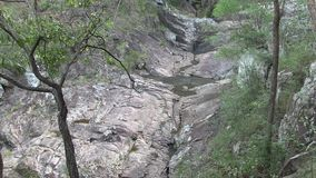Trickling water at Simpson Falls. West Ithaca Creek, is at the side of Mount Coo-tha, not far from the major look out over Brisbane City, Queensland, Australia stock video footage