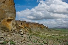 Lonely rocks of the boundless steppe. West Kazakhstan. In the boundless steppe there is a lonely mountain complex Shirkala, which from a distance looks like a royalty free stock photography