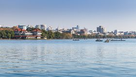 West Lake coast, panoramic landscape. Of Hangzhou city with ordinary local people in rowing boats, China Stock Photos