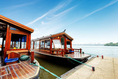 West Lake in Hangzhou, China. Traditional wooden row boat on famous West Lake, Hangzhou, China Stock Photos