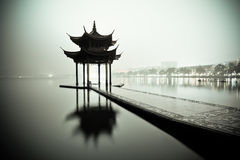 West lake of hangzhou at night. West lake of hangzhou and ancient pavilion at night stock photography