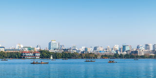 West Lake panorama with ordinary people in boats Royalty Free Stock Photography