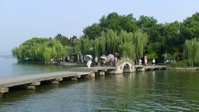 West lake with stone bridge Stock Photography