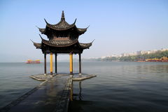 West Lake ( XiHu ). The beautiful west lake , XiHu, in Hangzhou with traditional chinese and peaceful architectural style Royalty Free Stock Photography