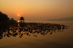 West Lake ( XiHu ). The beautiful west lake , XiHu, in Hangzhou with traditional chinese and peaceful architectural style Stock Photography