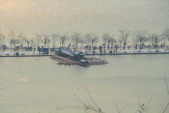 West Lake(xihu) in Hangzhou of China in winter after the snow when sun rises Stock Photos
