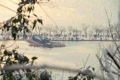 West Lake(xihu) in Hangzhou of China in winter after the snow when sun rises Royalty Free Stock Photography