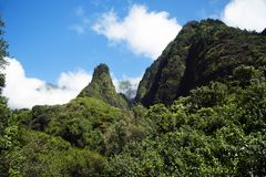West Maui Mountains above Iao Valley in Hawaii. Mountains rise above Iao Valley, on a sunny day in Maui, one of the Hawaiian Islands royalty free stock photos