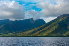 West Maui Mountains. West coast of Maui Hawaii where the Pacific meets the green mountains stock photos