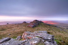 West Mill Tor on Dartmoor. Rain clouds descend over West Mill Tor near Okehampton on Dartmoor National Park in Devon royalty free stock image