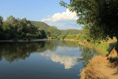 West Morava, Kraljevo, Serbia. View of the river bank with slopes of the mountain and vegetaated coastal landscape, the West Morava Royalty Free Stock Image