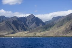 West Mountains in Maui Hawaii. This is a Photograph from the West Mountains with a Boat and a Blue Pacific Ocean in Maui Hawaii royalty free stock photography