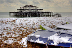 West Pier and Boats. View of Brighton and Hove`s West Pier and boats in the snow Royalty Free Stock Images