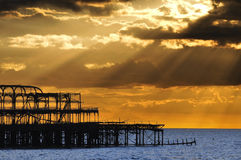 The West Pier in Brighton at sunset Stock Photos