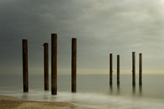 West Pier Pillars. The old pillars of Brighton and Hove`s West Pier against a cloudy sky at sun set Royalty Free Stock Photos