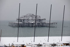 West Pier in The Snow. View of Brighton and Hove`s West Pier and boats in the snow Royalty Free Stock Photography