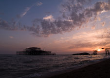 West Pier at sunset. The collapsed Brighton West Pier at sunset Stock Photos