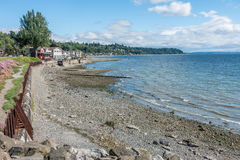West Seattle Shoreline Landscape. A view of the shoreline with homes and water in West Seattle, Washington stock image