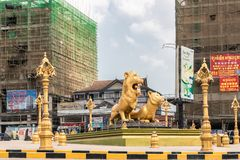 West side of Golden Lions roundabout, Sihanoukville Cambodia. Sihanoukville, Cambodia - March 15, 2019: Golden Lions Roundabout. West flank of giant statues of stock image
