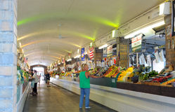 West Side Market arcade. CLEVELAND, OH - JUNE 27: Early morning custormers on June 27, 2012, shop in the produce arcade  of the famed West Side Market in Stock Photo