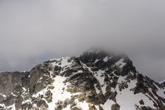 West side of Tre Signori peak summit  among clouds, Orobie Stock Photos