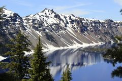 West slope of Crater Lake in July. The west slope of Crater Lake in Crater Lake National Park in Oregon, taken in July. I have this image printed to 20 x 30 and Royalty Free Stock Photos