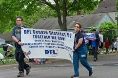 Supporters for Senate District 52 March at Festival. West St. Paul, MN/USA – May 19, 2018: Members of local Democratic-Farmer-Labor Party organizing unit hold Royalty Free Stock Photography