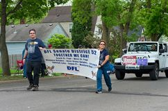 Supporters for Senate District 52 at Parade. West St. Paul, MN/USA – May 19, 2018: Members of local Democratic-Farmer-Labor Party organizing unit hold sign and Royalty Free Stock Photos