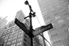 West 41st Street and Avenue of the American signs with buildings in black and white style. New York Royalty Free Stock Photo