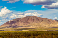 West Texas Mountains, with a Train, Clouds and Blue Sky. Stock Photos
