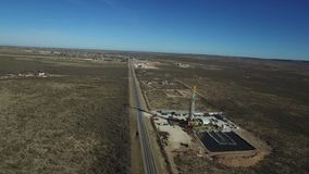 West texas oil boom. Around midland and odessa texas. oil rigs and pumping jacks dot the plains stock footage