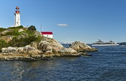 Arkinson Lighthouse in West Vancouver, with a Cruise ship in the background royalty free stock photo