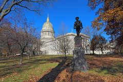 West Virginia capitol building in Charleston. Historical statue and dome of the West Virginia capitol building in Charleston against a blight blue autumn sky royalty free stock photography