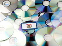 West Virginia flag on top of CD and DVD pile isolated on white Stock Images