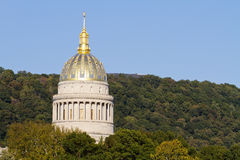 West Virginia State Capital Dome. The golden West Virginia State Capital Dome towering above the trees on an clear, early Fall evening, just before sunset in royalty free stock photos