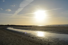 West Wittering, Sussex, England UK. Pilings and sun. royalty free stock image