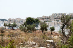Westbank-Siedlungen und Tränengas auf dem palästinensischen Gebiet Stockfotos