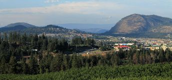 Westbank West Kelowna BC. A spectacular summer view of WestBank and the surrounding West Kelowna area. The town centre is surrounded by lush evergreens, rolling Royalty Free Stock Photos