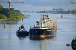 Westbound container ship entering Gatun Locks. A westbound container ship being guided into position for transiting the Gatun Locks on the Panama Canal Stock Photo