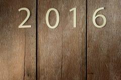 Westchnienie symbol od liczby 2016 na starym retro rocznika stylu drewniany t Zdjęcia Stock