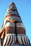 Westcoast Totem. Totem pole in northwest british columbia, canada set against blue sky Stock Image