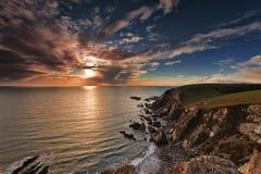 Westcombe Strand-Sonnenuntergang stockfotos